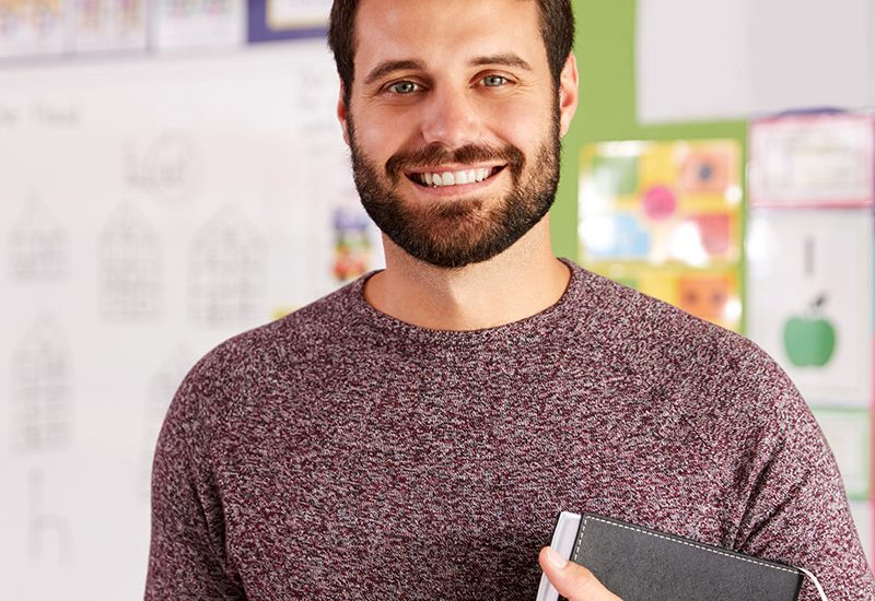 portrait-of-male-elementary-school-teacher-standin-FHS34DB.jpg