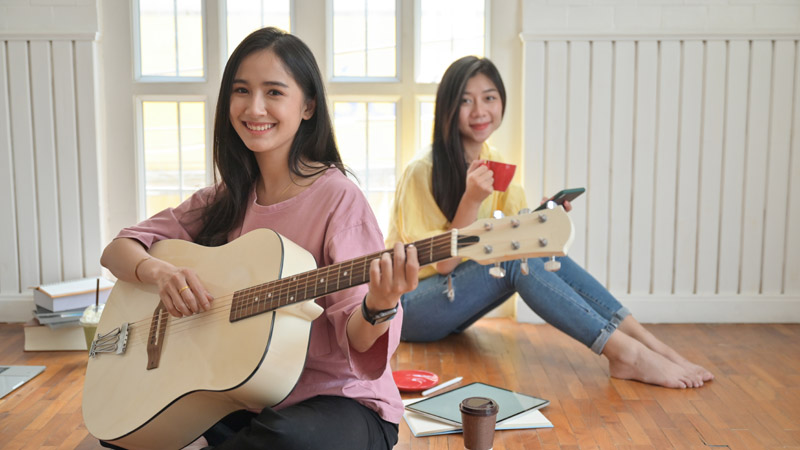 teenage-girls-are-singing-and-playing-guitars-they-NJUHDBF.jpg